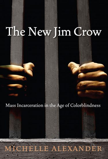 Cover of Michelle Alexander's The New Jim Crow: Mass Incarceration in the Age of Colorblindness. Two hands, apparently black and male, grasping the bars of a prison cell are pictured against a black background.