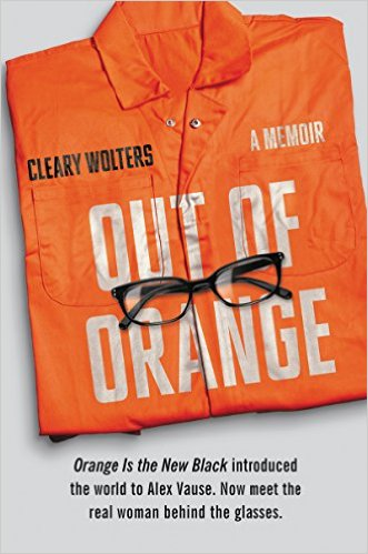 The cover of Cleary Wolter's memoir, Out of Orange. An orange jumpsuit is pictured folded neatly with a pair of black-rimmed glasses sitting on top of it. The title of the novel appears to be printed on the jumpsuit in white text.