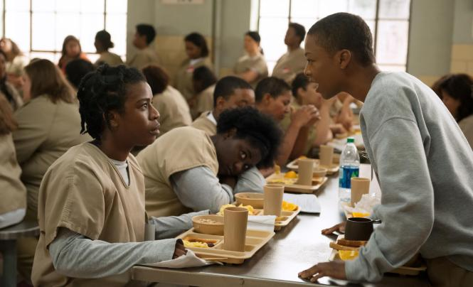 "Suzanne ""Crazy Eyes"" Warren (Uzo Aduba), left, and Poussey Washington (Samira Wiley) are inmates at the Litchfield Penitentiary in the Netflix series Orange Is the New Black, which returns for its third season on Friday."