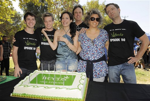 "Jenji Kohan, second from right, executive producer and creator of the Showtime series Weeds, poses with the show's cast members, from left, Alexander Gould, Hunter Parrish, Mary-Louise Parker, Kevin Nealon and Justin Kirk at a party to celebrate the show's 100th episode, Tuesday July 17, 2012, in Los Angeles. ""Weed"" is in its final season and will end its eight-year run in September. (Photo by Chris Pizzello/Invision/AP)"